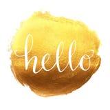 Hello hand lettering on splash golden background Stock Photo