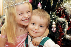 Hello holiday. The little children, brother and sister greeted the new year holiday and Christmas royalty free stock photo