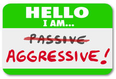 Hello I am Aggressive Vs Passive Action or Inaction Attitude. A green nametag with the words Hello I Am Aggressive and the word Passive crossed out to illustrate Royalty Free Stock Photos