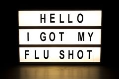 Hello I got my fly shot light box sign board. On wooden table stock photo