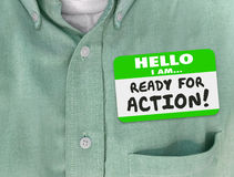 Hello I Am Ready for Action Nametag Green Shirt. Hello I Am Ready for Action words written on green nametag sticker on a shirt of an employee or worker Royalty Free Stock Photography