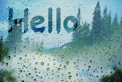 Hello. The inscription on wet window `Hello Royalty Free Stock Images