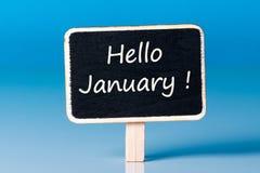 Hello Januari kort med blå bakgrund Januari 1st, början av det nya året Arkivfoton