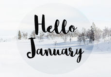 Hello January. Black text graphic Hello January over wintry rural landscape stock images