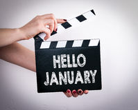 Hello January. Female hands holding movie clapper.  Stock Photography