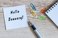 Hello January greeting on paper at home or office workplace, New year beginning concept. business background Stock Image