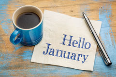 Hello January on napkin. Hello January - handwriting on a napkin with a cup of coffee Stock Photography