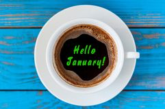 Hello January - text on morning coffee mug. Top view, New year hangover concept.  Royalty Free Stock Photos
