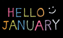 Hello January written on blackboard Stock Photography
