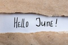 Hello June - inscription at brown torn envelope. First summer day, Calendar concept Royalty Free Stock Image