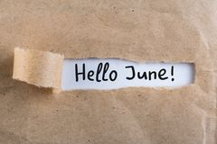 Hello June - inscription at brown torn envelope. First summer day, Calendar concept Royalty Free Stock Photos