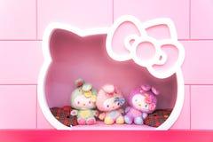 Hello Kitty plush dolls on pink display shelf, Hello Kitty Cafe, Jeju island, South Korea. stock photography