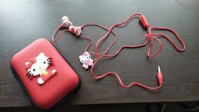 Hello Kitty pudełka i earpiece set zdjęcie royalty free