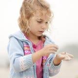 Hello, ladybug. Little beautiful girl with ladybug in hand Royalty Free Stock Images