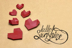 Hello lovelly sunshine!. Heart's on pack paper with hello Sunshine hand drawn quotes royalty free stock photo