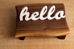 Hello on Mahogany Table Stock Photos