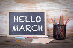 Hello March concept. Old wooden table with texture.  royalty free illustration