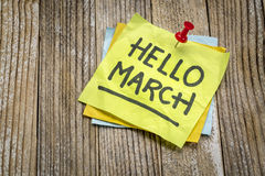 Hello March greetings on a sticky note stock photos