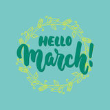Hello,March - hand drawn lettering phrase for first month of spring isolated on the blue background with wreath. Fun brush ink ins. Cription for photo overlays Stock Photos
