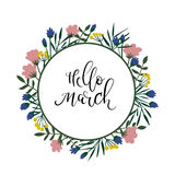 Hello March hand lettering text. Spring greeting card. Floral wreath Stock Photography