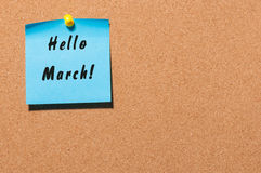 Hello March - Note With Text pinned at cork notice board. With empty space. Spring begin concept Royalty Free Stock Image
