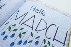 Hello March Printed Paper on White Surface Royalty Free Stock Image