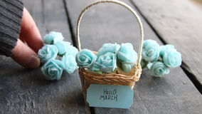 Hello March. Rustic still life, roses and tag. Hello March. Label and beautiful basket of roses on vintage table stock video