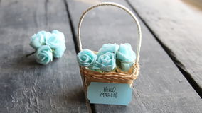 Hello March. Rustic still life, roses and tag. Hello March. Label and beautiful basket of roses on vintage table stock footage