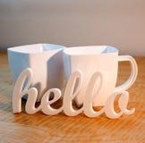 Hello met de Mokken van de Koffie Royalty-vrije Stock Foto's