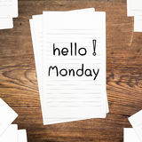 Hello Monday on paper. And wood table desk Stock Image