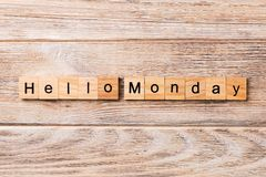 Hello Monday word written on wood block. hello Monday text on wooden table for your desing, concept royalty free stock photography