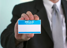 Hello my name is... Man holding a card that says Hello my name is with blank space for your message. Social networking, business, and other networking concepts stock photos