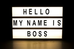 Hello my name is boss light box sign board. On wooden table royalty free stock photos