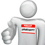 Hello My Name is Opportunity Nametag Handshake. A person holds out his hand for a handshake, greeting you with a nametag reading Hello My Name is Opportunity Royalty Free Stock Photography
