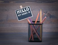 Hello My Name Is. A small blackboard chalk and colored pencil on wood background stock photography