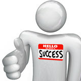 Hello My Name is Success Nametag Person Handshake. A person holds out his hand for a handshake, greeting you with a nametag reading Hello My Name is Success Royalty Free Stock Images