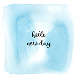 Hello new day text on blue watercolor background Royalty Free Stock Images