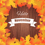 Hello november. Bright colourful autumn leaves on wood background Stock Image