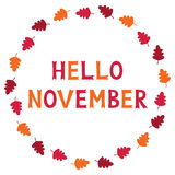 Hello November, card with autumn leaves, text in hand lettered font Royalty Free Stock Photography