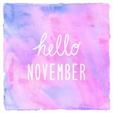 Hello November text on pink blue and violet watercolor backgroun stock photography