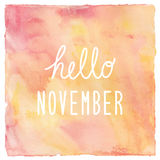 Hello November text on red and yellow watercolor background Stock Photography