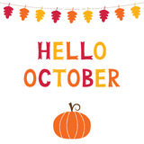 Hello October, card with a pumpkin, text in hand lettered font Stock Photo