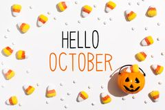 Hello October message with pumpkin overhead view Stock Image