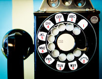 Hello Operator...Please give me number 9. An old rotary dial pay phone Stock Photo