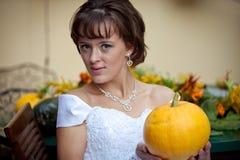 Hello pumpkin. Beautiful woman holds a pumpkin Royalty Free Stock Photos