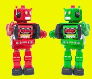 Hello robot red free yellow. Two retro robot say hellow on a bright yellow background Royalty Free Stock Images