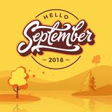 Hello September round badge with autumn landscape. Flat style. Vector typography. Brush lettering for banner, poster. Greeting card. Vector handwritten royalty free illustration