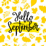 Hello September. The trend calligraphy. Vector illustration on a beautiful background of golden autumn leaves. Smear of yellow ink. Concept autumn advertising stock illustration