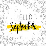 Hello September. The trend calligraphy. Vector illustration on white background with a smear of ink and yellow autumn icons. Concept autumn advertising Stock Photos