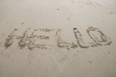 Hello sign word drawing on the sand background Stock Photos